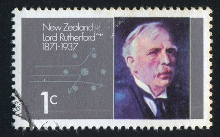 NEW ZEALAND - CIRCA 1971: stamp printed by New Zealand, shows Lord Rutherford and Alpha Particles Passing Atomic Nucleus, circa 1971 報道画像