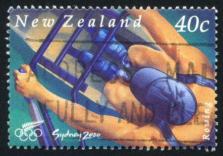 summer olympics: NEW ZEALAND - CIRCA 2000: stamp printed by New Zealand, shows Rower at Summer Olympics in Sydney, circa 2000