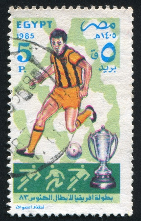 EGYPT - CIRCA 1985: stamp printed by Egypt, shows Football player, ball, cup, circa 1985