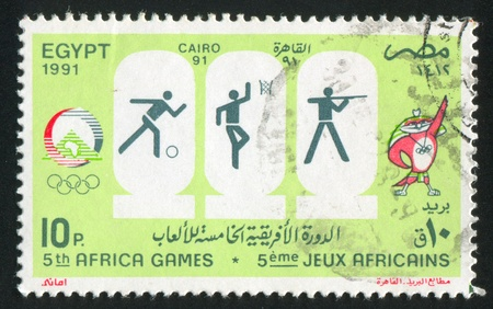 EGYPT - CIRCA 1991: stamp printed by Egypt, shows Mascot, Olympic emblem, circa 1991 Stock Photo - 13581144