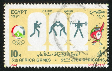 EGYPT - CIRCA 1991: stamp printed by Egypt, shows Mascot, Olympic emblem, circa 1991