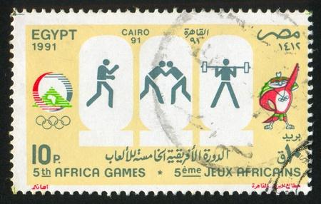 EGYPT - CIRCA 1991: stamp printed by Egypt, shows Mascot, Olympic emblem, circa 1991