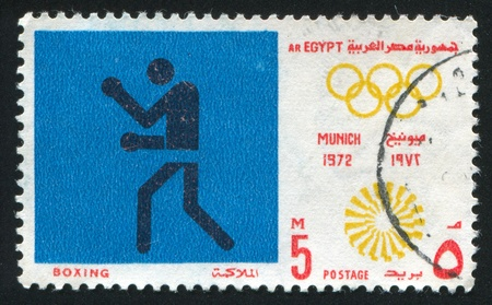 EGYPT - CIRCA 1972: stamp printed by Egypt, shows Boxing, Olympic emblem, circa 1972 Stock Photo - 13581158