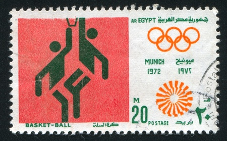 EGYPT - CIRCA 1972: stamp printed by Egypt, shows Basketball, Olympic emblem, circa 1972