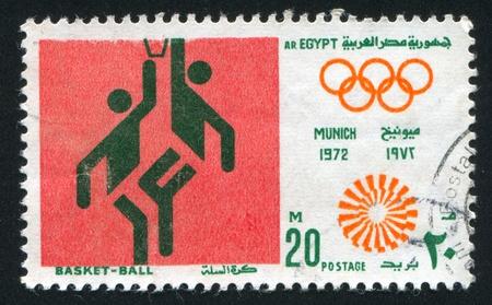 EGYPT - CIRCA 1972: stamp printed by Egypt, shows Basketball, Olympic emblem, circa 1972