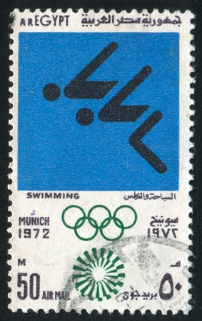 EGYPT - CIRCA 1972: stamp printed by Egypt, shows Swimming, Olympic emblem, circa 1972