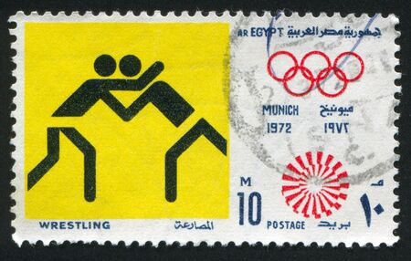 EGYPT - CIRCA 1972: stamp printed by Egypt, shows Wrestling, Olympic emblem, circa 1972