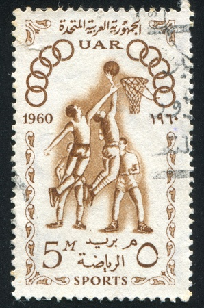olympic symbol: EGYPT - CIRCA 1960: stamp printed by Egypt, shows Basketball players and spectators, circa 1960 Editorial