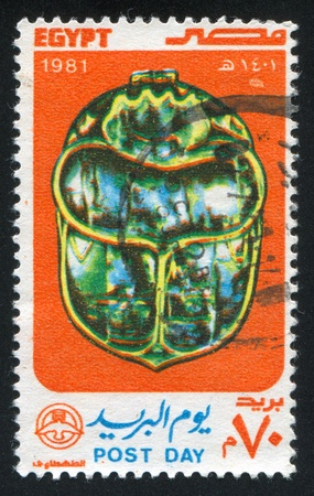 EGYPT - CIRCA 1981: stamp printed by Egypt, shows Ladybug Scarab emblem, circa 1981 Stock Photo - 13591893
