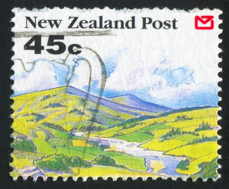 NEW ZEALAND - CIRCA 1992: stamp printed by New Zealand, shows Scenic Views of New Zealand, Hills, stream, circa 1992 photo