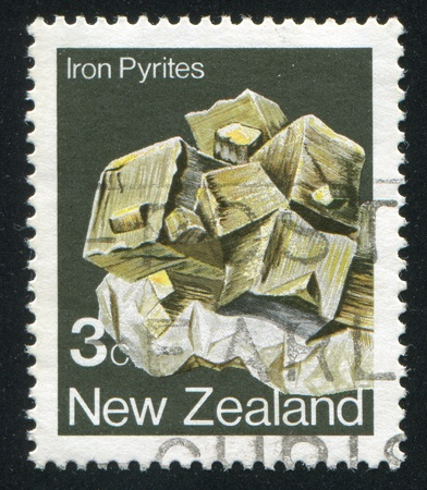 NEW ZEALAND - CIRCA 1982: stamp printed by New Zealand, shows Crystal, Iron pyrites, circa 1982 Stock Photo - 13591842