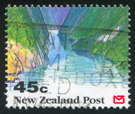 NEW ZEALAND - CIRCA 1992: stamp printed by New Zealand, shows Scenic Views of New Zealand, Fjord, circa 1992 photo