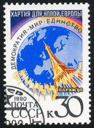RUSSIA - CIRCA 1990: stamp printed by Russia, shows Globe, Eiffel Tower, circa 1990 photo