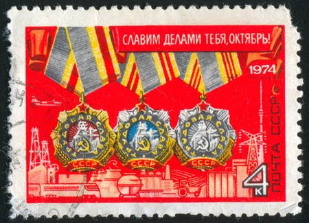 RUSSIA - CIRCA 1974: stamp printed by Russia, shows Order of Labor 1st, 2nd and 3rd Grade, circa 1974 Stock Photo - 13591538