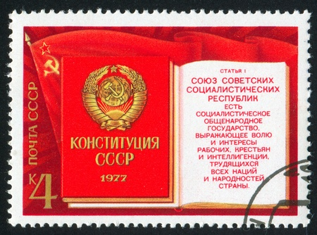 RUSSIA - CIRCA 1977: stamp printed by Russia, shows Flag of USSR, Constitution (Book) with Coat of Arms, circa 1977 photo