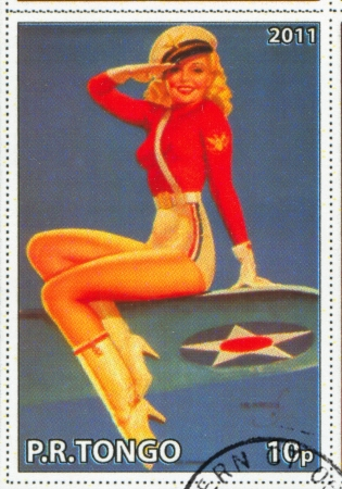 TONGO - CIRCA 2011: stamp printed by Tongo, shows Pin-up girl, by Earl MacPherson, circa 2011
