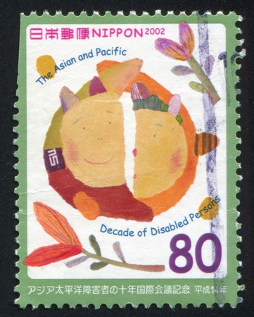 JAPAN - CIRCA 2002: stamp printed by Japan shows Faces, circa 2002 photo
