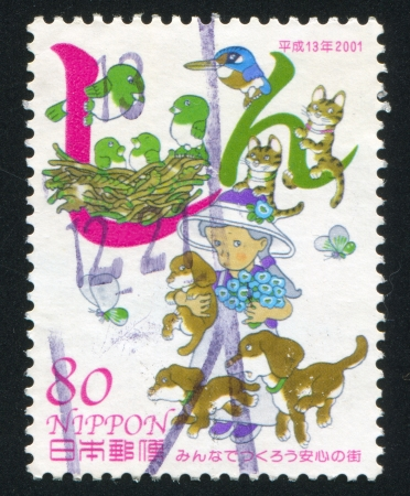 JAPAN - CIRCA 2001: stamp printed by Japan shows Girl, Dogs, Cats, Birds, Insects, circa 2001 photo