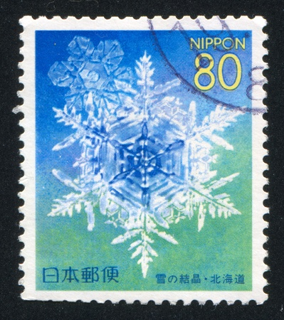 JAPAN - CIRCA 1999: stamp printed by Japan shows Snowflake, circa 1999 Stock Photo - 13703598