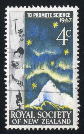 NEW ZEALAND - CIRCA 1967: stamp printed by New Zealand, shows Mt. Aspiring, aurora australis and Southern Cross, circa 1967 photo