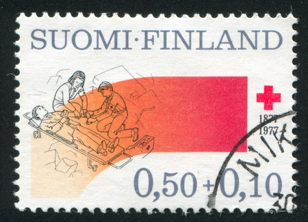 FINLAND - CIRCA 1977: stamp printed by Finland, shows Disaster Relief, circa 1977 Stock Photo - 13763828
