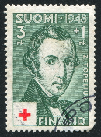 FINLAND - CIRCA 1948:  stamp printed by Finland, shows portrait of Zachris Topelius, circa 1948 Stock Photo - 13893445