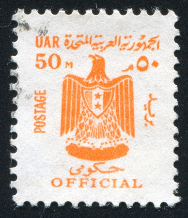 EGYPT - CIRCA 1959: stamp printed by Egypt, shows Eagle, Arms of Egypt, circa 1959. photo