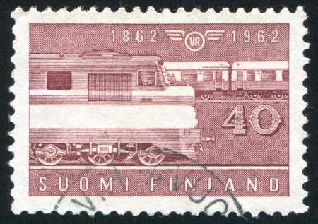 FINLAND - CIRCA 1962: stamp printed by Finland, shows Diesel locomotive and passenger train,  circa 1962 photo