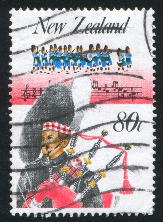aerophone: NEW ZEALAND - CIRCA 1986: stamp printed by New Zealand, shows Music, Highland pipe band and piper, circa 1986
