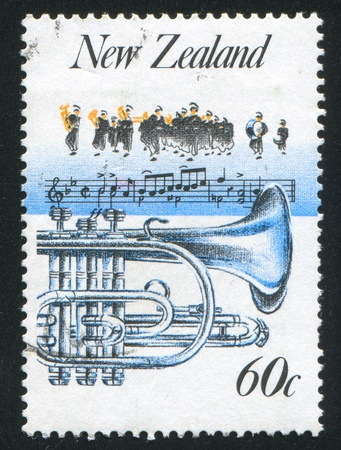 aerophone: NEW ZEALAND - CIRCA 1986: stamp printed by New Zealand, shows Music, Brass band and tuba, circa 1986 Stock Photo