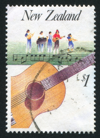 resonator: NEW ZEALAND - CIRCA 1986: stamp printed by New Zealand, shows Music, Guitar and Country music, circa 1986