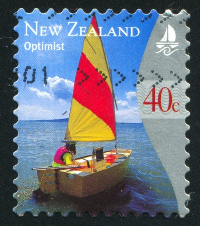 NEW ZEALAND - CIRCA 1999: stamp printed by New Zealand, shows Yachting, Optimist, circa 1999 photo
