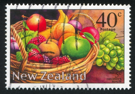 NEW ZEALAND - CIRCA 2002: stamp printed by New Zealand, shows Fruits in the basket, circa 2002 photo
