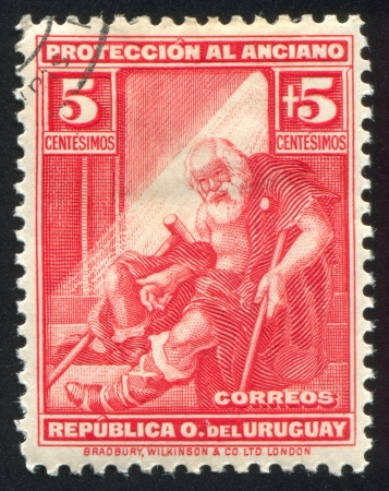 impoverished: URUGUAY - CIRCA 1930: stamp printed by Uruguay, shows Indigent Old Man, circa 1930