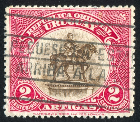 URUGUAY - CIRCA 1923: stamp printed by Uruguay, shows Equestrian Statue of Artigas, circa 1923 Stock Photo - 13891765