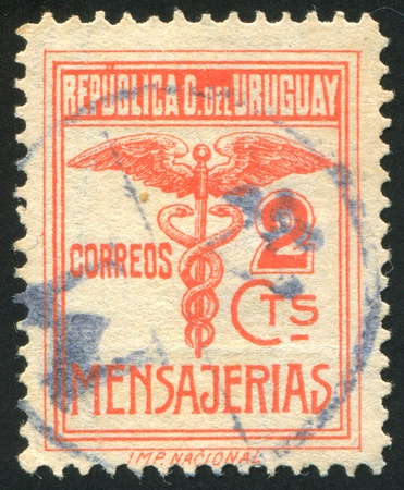 URUGUAY - CIRCA 1922: stamp printed by Uruguay, shows Caduceus, circa 1922 Stock Photo - 13891701