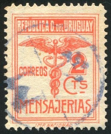 URUGUAY - CIRCA 1922: stamp printed by Uruguay, shows Caduceus, circa 1922 Stock Photo - 13891701