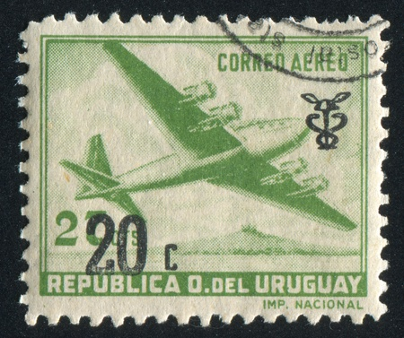 URUGUAY - CIRCA 1947: stamp printed by Uruguay, shows Four-Motored Plane, circa 1947 photo