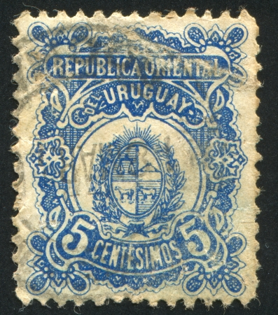 URUGUAY - CIRCA 1906: stamp printed by Uruguay, shows Coat of Arms, circa 1906 photo