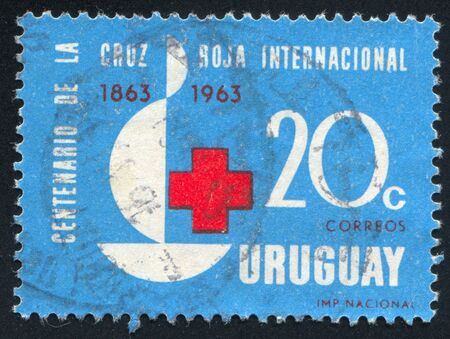 URUGUAY - CIRCA 1964: stamp printed by Uruguay, shows Red Cross, Centenary Emblem, circa 1964 Stock Photo - 13891707