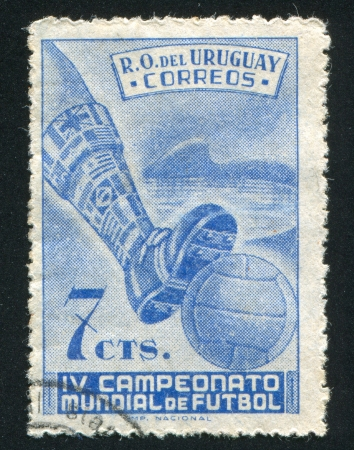 URUGUAY - CIRCA 1950: stamp printed by Uruguay, shows Symbolical of Soccer Matches, circa 1950 photo