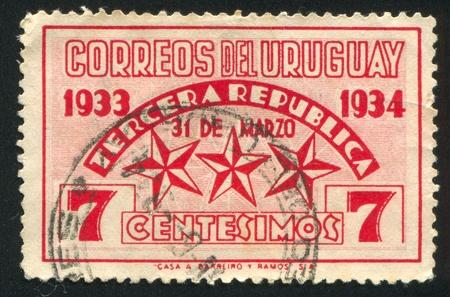 URUGUAY - CIRCA 1934: stamp printed by Uruguay, shows Stars Representing the Three Constitutions, circa 1934 Stock Photo - 13891736