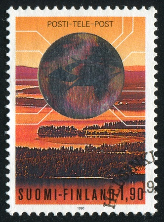 holography: FINLAND - CIRCA 1990: stamp printed by Finland, shows Emblem of the State Posts and Telecommunications Services Corporation, circa 1990