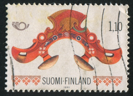 FINLAND - CIRCA 1980: stamp printed by Finland, shows Back-piece Harness, circa 1980 photo