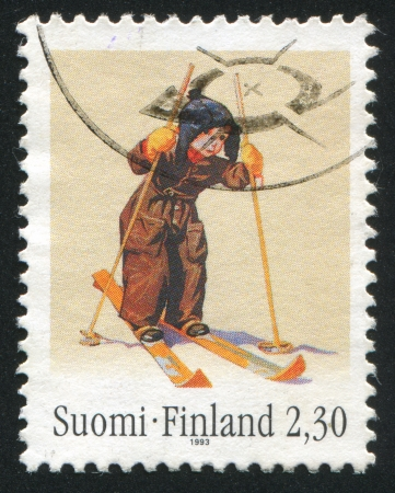 FINLAND - CIRCA 1993: stamp printed by Finland, shows Boy on Skis by Martta Wendelin, circa 1993 photo