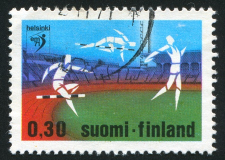 FINLAND - CIRCA 1971: stamp printed by Finland, shows Athletes at the Stadium, circa 1971 photo