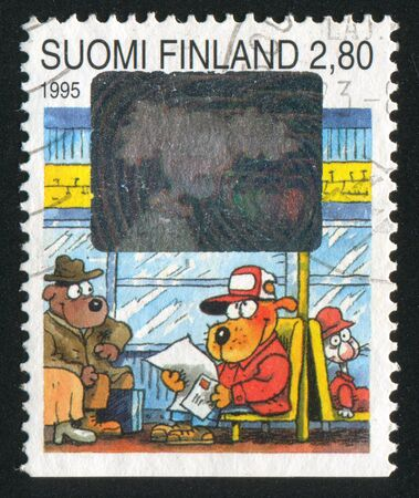 FINLAND - CIRCA 1995: stamp printed by Finland, shows Dog Reading Letter, circa 1995 photo