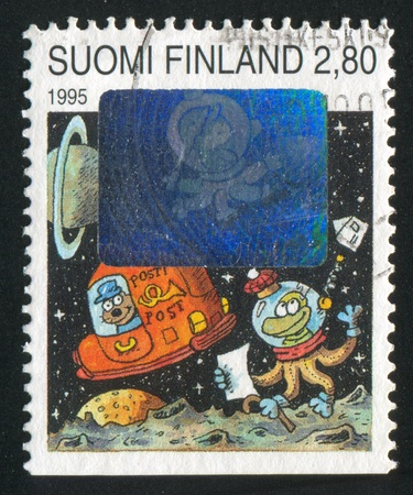 FINLAND - CIRCA 1995: stamp printed by Finland, shows Spaceman getting Letter, circa 1995 photo