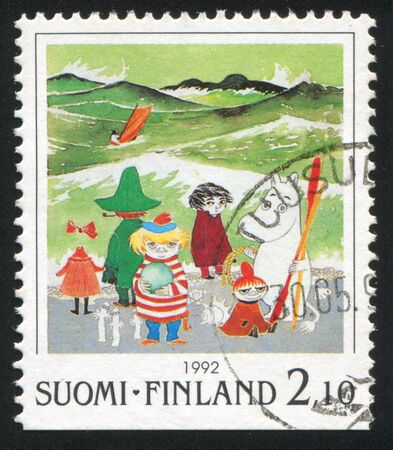FINLAND - CIRCA 1992: stamp printed by Finland, shows Moomin characters on beach, circa 1992 Stock Photo - 13891936