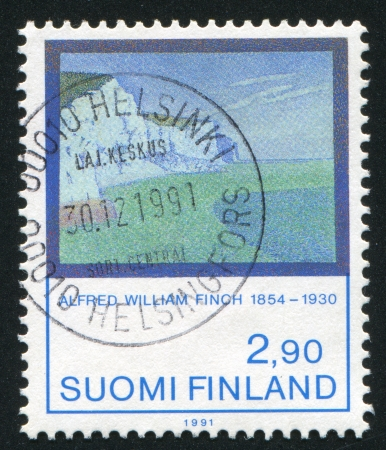 FINLAND - CIRCA 1991: stamp printed by Finland, shows The Cliffs at South Foreland by Alfred Finch, circa 1991 photo